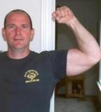 military dude flexing biceps.jpg