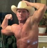 muscle flexing cowboy big biceps hot chest.jpg