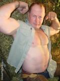 rancher daddy cowboy shirtless flexing muscles.jpg