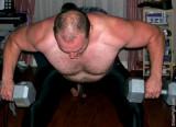 hairy beefy man lifting weights.jpeg