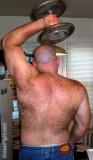hairyback bald man lifting weights.jpeg