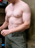 hot muscle man gym shorts resting between sets.jpg