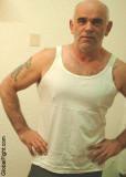 hot older balding man tanktop.jpeg
