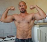huge double biceps posing flexed muscles flexing.jpg