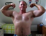 huge dude dorm jock athletic department flexing.jpg