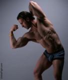 huge muscular professional bodybuilder flexing biceps.jpg