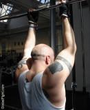 huge powerlifter tattooed man gym lifting.jpeg