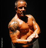 huge veiny veiny muscles biceps bodybuilder flexing.jpg