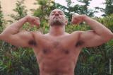 large muscles man muscular jock biceps flexing.jpg