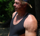man big arms jogging in park.jpg