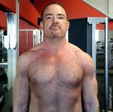 man gay gym flexing no shirt workout.jpg