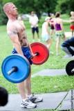 man lifting weights shirtless in park workout.jpg