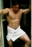 man wearing towel hottub sauna jacuzzi.jpg
