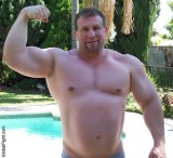 massive huge strong man powerlifter lifting big biceps.jpg