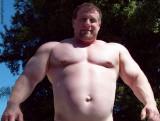 monster powerlifter strongman poolside swimming.jpg