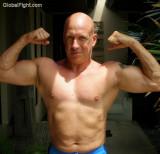 muscle bald jock posing.jpeg