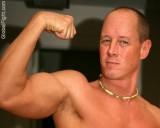 balding crewcut military muscles man.jpeg
