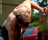 baseballcap man washing truck.jpg