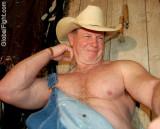 biceps cowboy daddy flexing.jpg