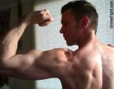 biceps flexing rear view.jpg