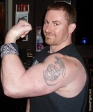 big biceps muscleman flexing tattoos arms.jpg