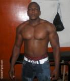 black muscle gay man huge biceps.jpg