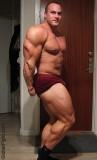 bodybuilder flexing huge calves.jpeg