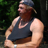 candid man removing shirt tanktop.jpg