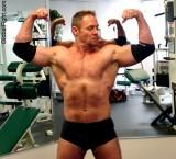 goatee muscleman flexing gym.jpeg