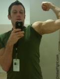 gym lockerroom boy flexing.jpg