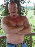 bald shirtless ranching rancher farmer cattle man.jpg