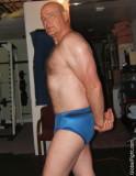 tricep posing hairy gym built man.jpg