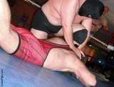 professional wrestling show event hairy mans back pushed.jpg