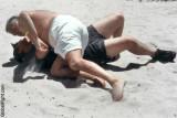 sandy guys beach fighting men.jpeg