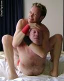 sleeper choke hold mat men wrestling.jpg
