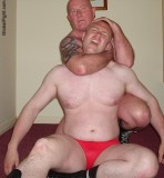 speedos bear wrestling knocked out fighting mens photos.jpg