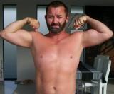 super handsome very hairy bearded man flexing biceps.jpg