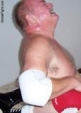 sweaty big thick neck man bear wrestling.jpg