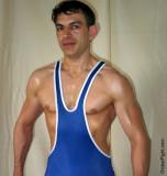 sweaty wrestling guy singlet posing muscleboys.jpg