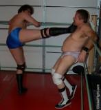 tiedup on ropes man kicked into turnbuckles wrestling.jpg