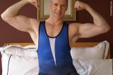 very handsome wrestler boy in singlet flexing bedroom.jpg