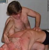 wrestler applying stomach claw hold.jpeg