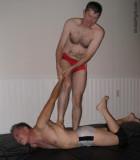 wrestler beating helpless man hairychest guys.jpg