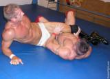 wrestler caught leg squeezing vice grip.jpeg