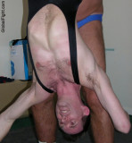wrestler man held upside down.jpeg