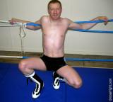 wrestler tiedup on ropes.jpeg
