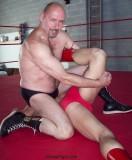 beefy wrestling daddy pinning opponent.jpg
