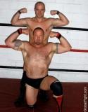 biceps flexing wrestling beefcakes.jpeg
