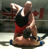 big guy beating up smaller man dude.jpg