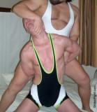 big man restraining hot younger jock dude.jpg